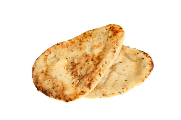 Naan breads Two naan breads isolated against white naan bread stock pictures, royalty-free photos & images