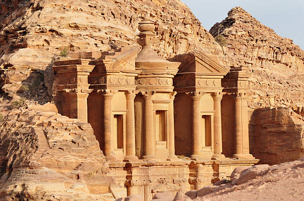 """Nabatean architecture at the Monastery in Petra, Jordan The Monastery -- """"al Deir"""" in Arabic -- in Petra, Jordan. It was carved out of the mountainside in the first century. greco roman style stock pictures, royalty-free photos & images"""