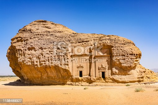 Stock photograph of rock-cut tombs of Mada'in Saleh, from the time of the Nabatean kingdom, UNESCO world heritage site near Al Ula, Saudi Arabia.