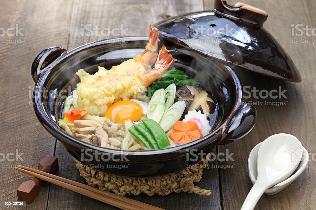 nabeyaki udon, japanese hot pot noodle stock photo