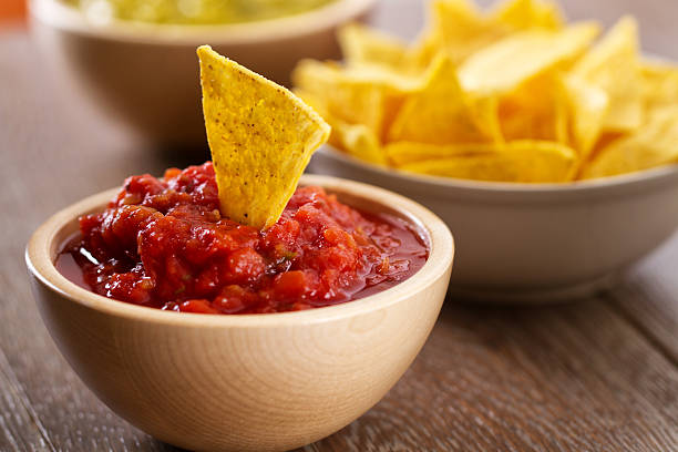 Nacho Chips with Salsa Nacho Chips with Salsa salsa sauce stock pictures, royalty-free photos & images