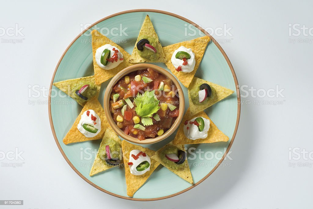 Nachos and a bowl of salsa royalty-free stock photo