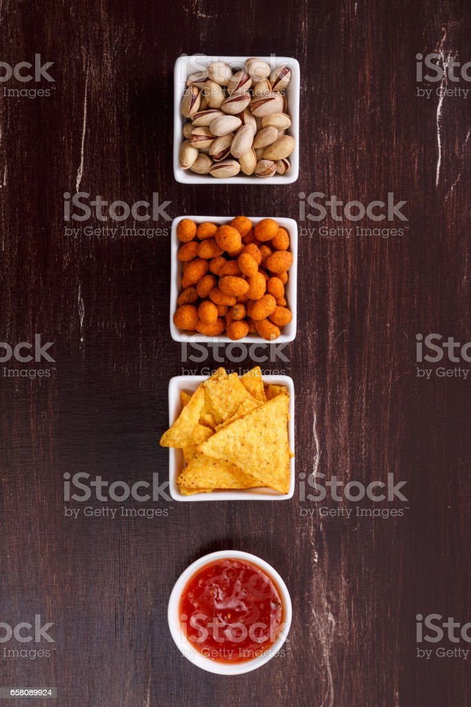 Nachos chips. Tortilla snack. Mexican salsa nuts. royalty-free stock photo