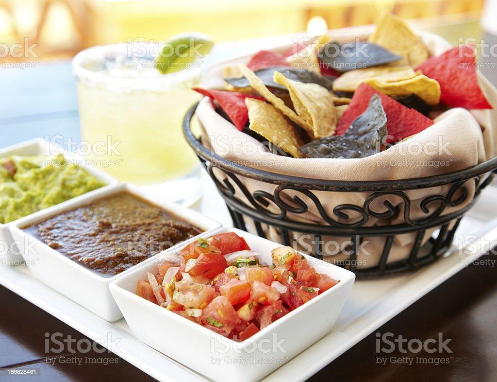 Nachos guacamole and tomato dip with margarita royalty-free stock photo