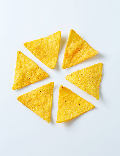 nachos - triangle shape stock photos and pictures