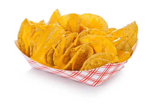 Nachos with just cheese, in a standard restaurant paper tray.