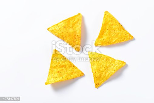 four nachos - tortilla chips isolated on white background