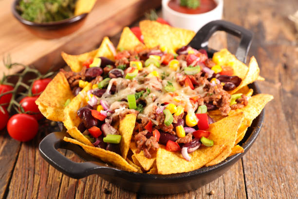 nachos with beef, vegetable and cheese stock photo