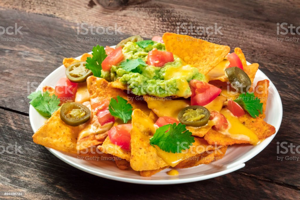 Nachos with cheese and hot peppers, traditional Mexican snack stock photo