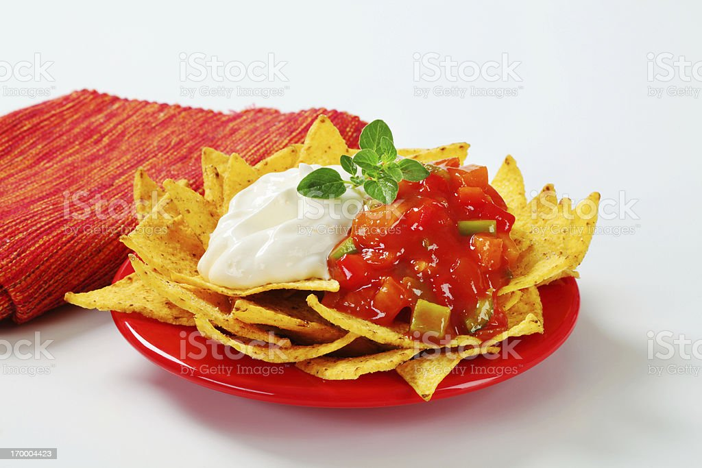 Nachos with salsa and cream royalty-free stock photo