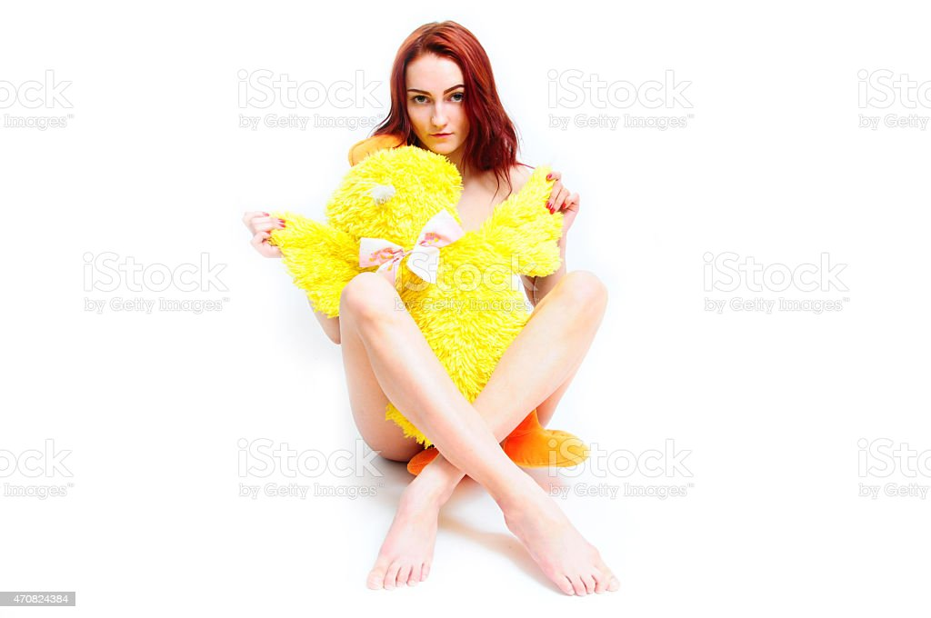 Nacked Girl Covering Herself With Yellow Duck Soft Toy Stock Photo