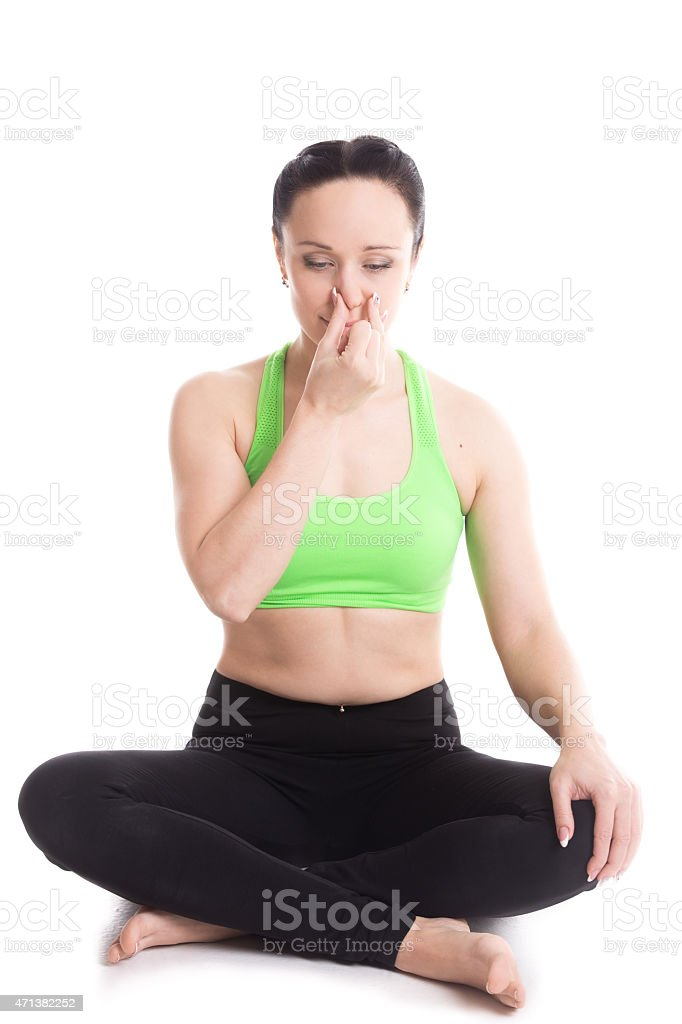 Nadi shodhan pranayama in yoga Easy pose stock photo