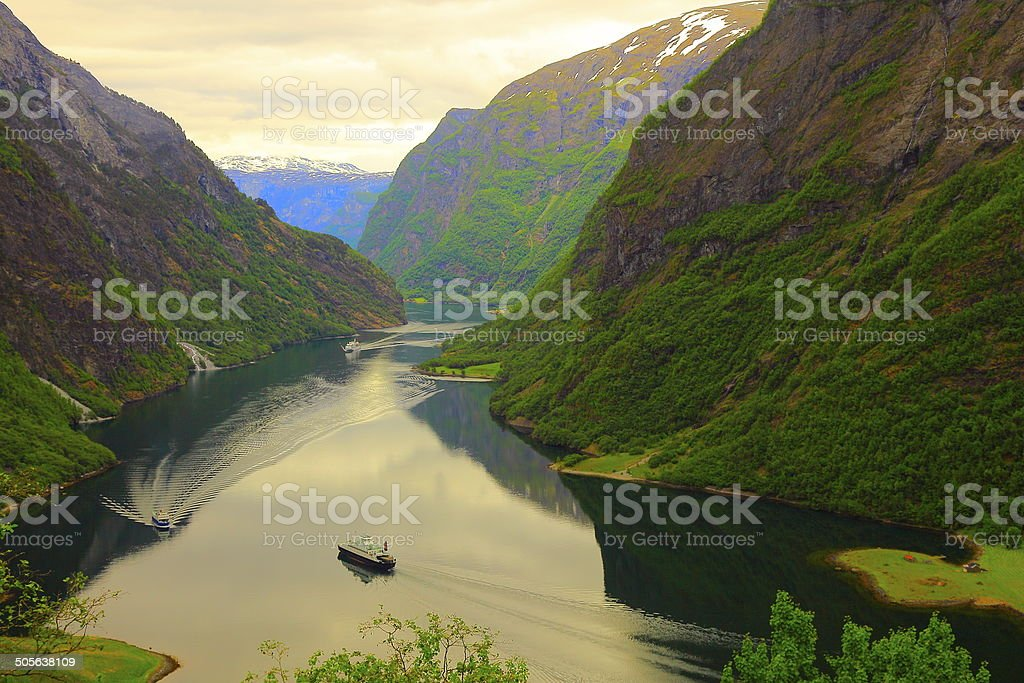 Naeroyfjord: fjord mountains and cruises crossing water, Norway stock photo