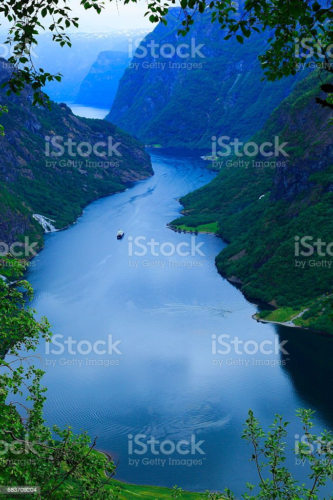Naeroyfjord idyllic fjord landscape, ship Cruise, dramatic evening, Norway, scandinavia stock photo