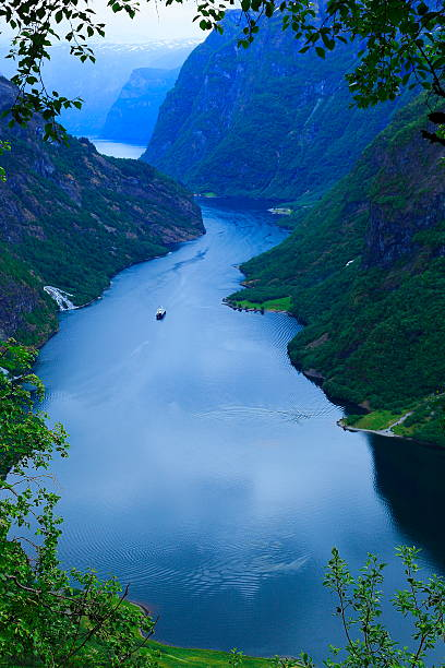 naeroyfjord idyllic fjord landscape, ship cruise, dramatic evening, norway, scandinavia - fjord stock photos and pictures