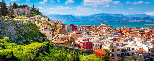 Nafplio, Greece aerial view and snow mountains stock photo