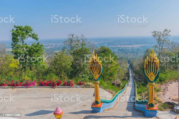 Photo of Naga symbol the long steps walkway, stairway to the temple.The public domain made from donation money from people in the village.