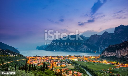 Elevated view on Nago-Torbole and Lake Garda at sunset