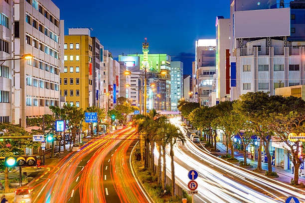 Naha, Japan Downtown Cityscape Naha, Okinawa, Japan downtown cityscape over the expressway. naha stock pictures, royalty-free photos & images
