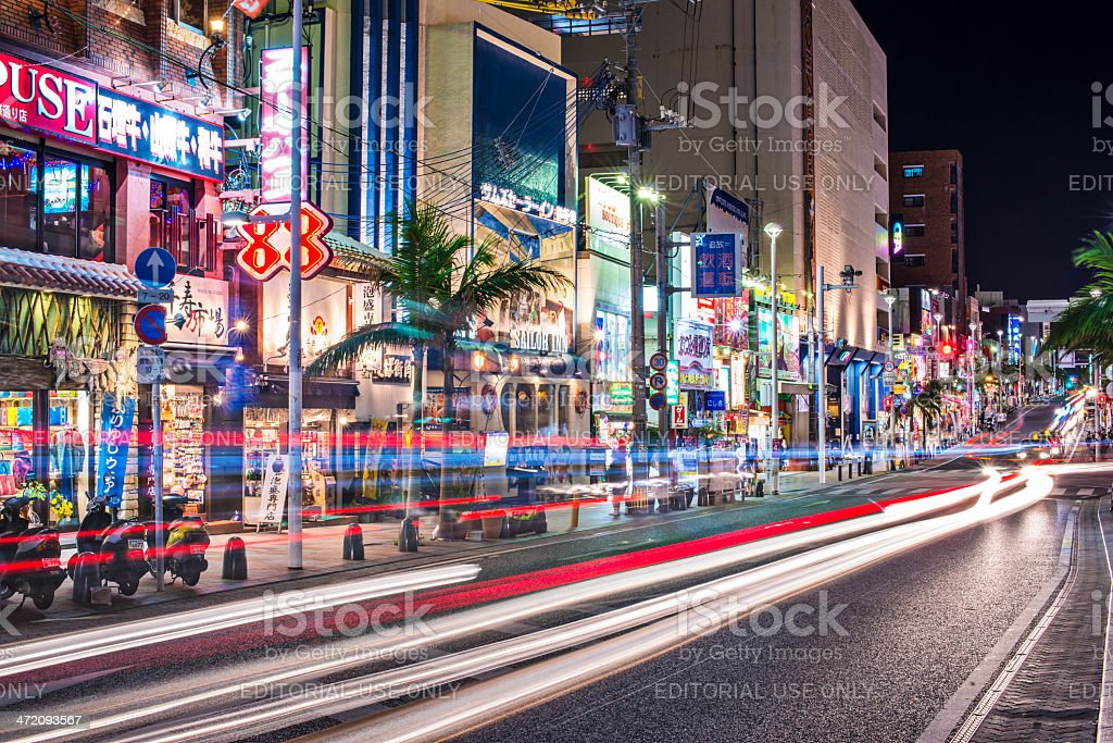 Naha, Japan Naha, Japan - November 12, 2012:  Traffic passes through International Street. The street is the main thoroughfare and entertainment district of the city. Asia Stock Photo