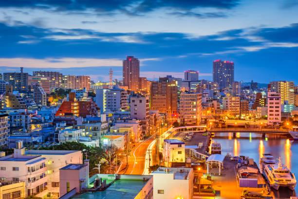 Naha, Okinawa, Japan Skyline Naha, Okinawa, Japan downtown skyline at night. naha okinawa stock pictures, royalty-free photos & images