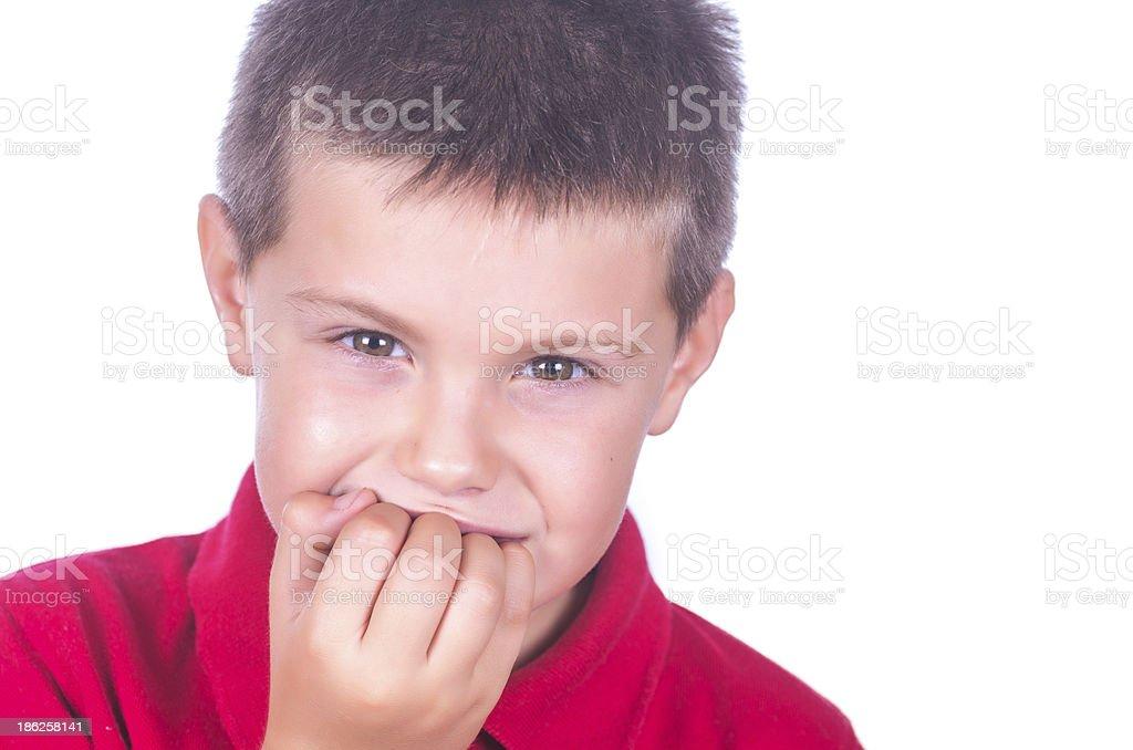 Nail biting child stock photo