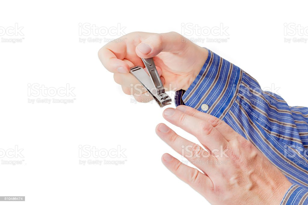 Nail clipper in the compound lever style in male hands stock photo