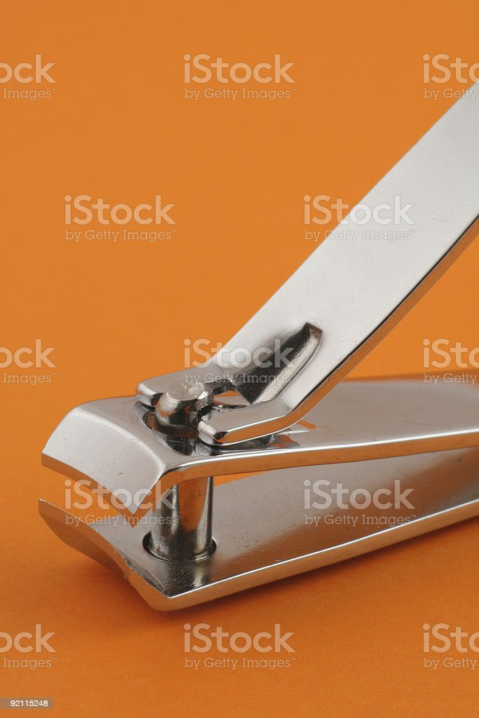 nail clippers on orange stock photo