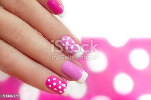 istock Nail design with white dots. 526657177