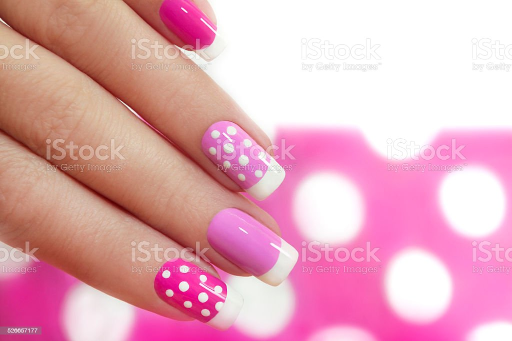 Nail design with white dots. stock photo