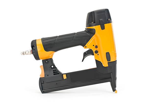 nail gun isolated on white - 釘 個照片及圖片檔
