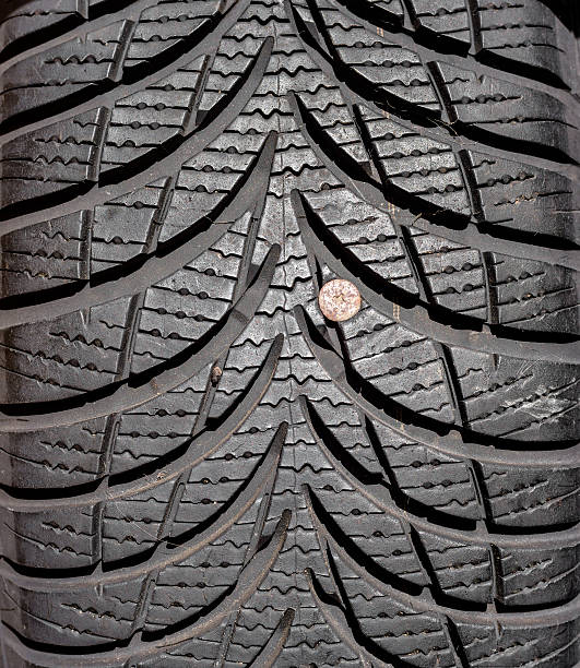 Royalty Free Nail Tire Pictures, Images and Stock Photos - iStock