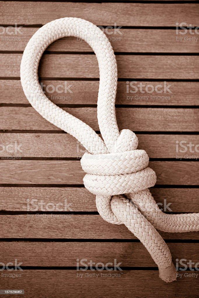 Nail knot on a sail boat deck royalty-free stock photo