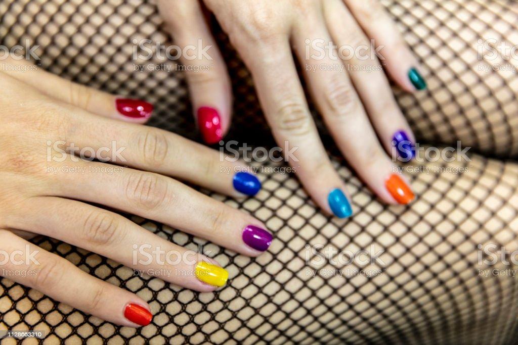 Nail Polish. Art Manicure. Multi-colored Nail Polish. Beauty hands....