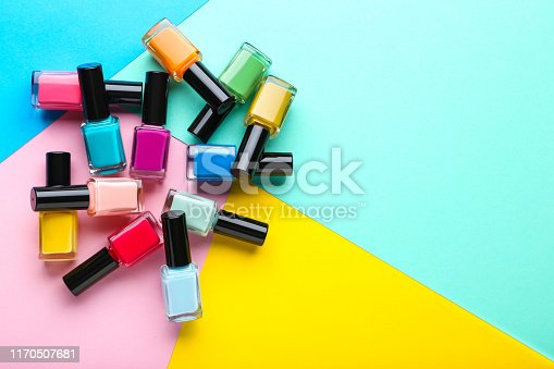 Nail polish bottles on colorful background