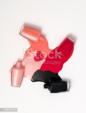Nail polish bottles with splash isolated on white background (with clipping path)