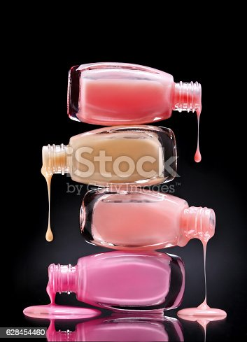 istock Nail polish dripping from open bottles 628454460