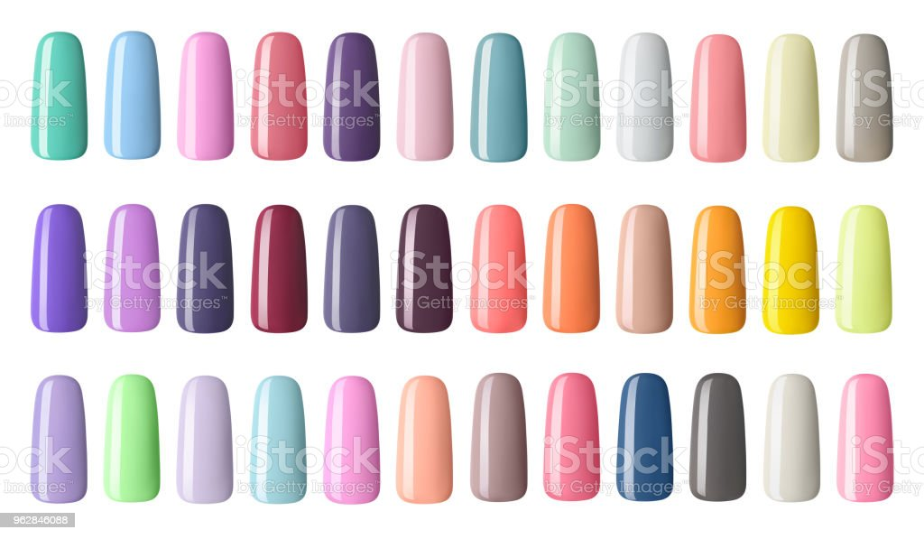 Nail polish in different fashion color. Colorful nail lacquer in tips  isolated white background stock photo