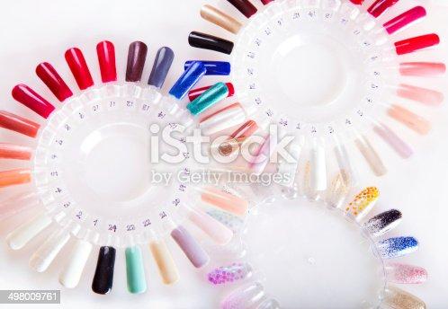 946930880istockphoto Nail polish, manicure, gel color sample disks. 498009761