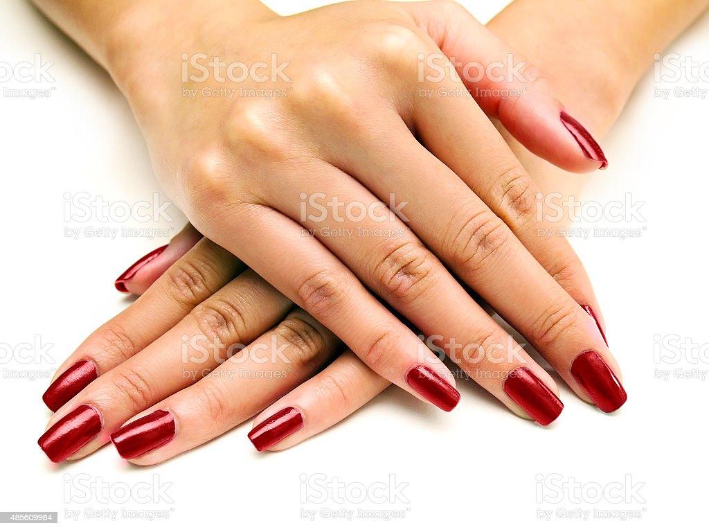 Nail Polish on Female Hands stock photo
