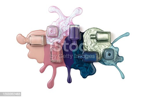 Nail polish splash form bottles isolated on white background (with clipping path)