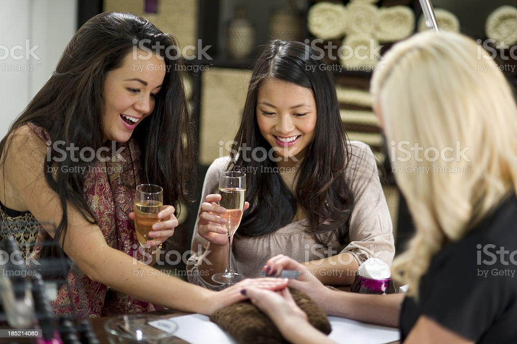 nail salon friends royalty-free stock photo