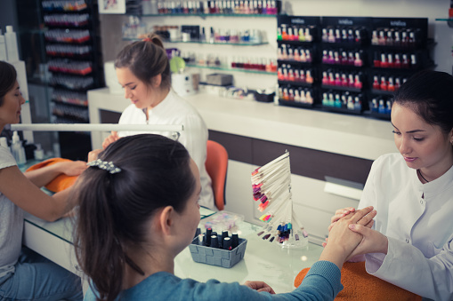 istock Nail technicians performing manicure 970223704