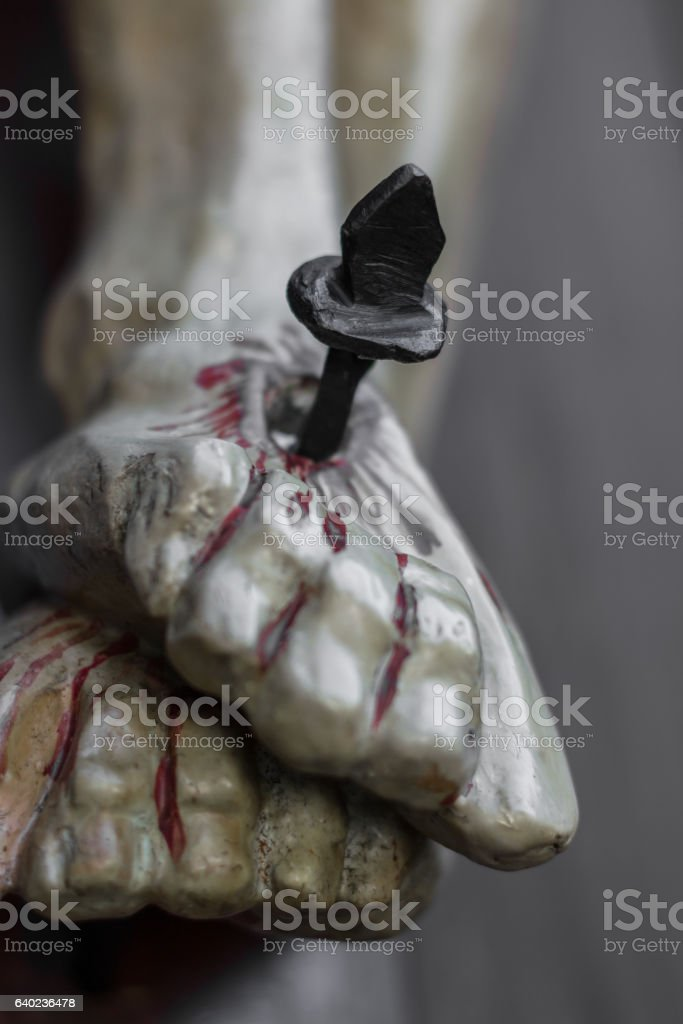 Nailed and bleeding feet of Jesus stock photo