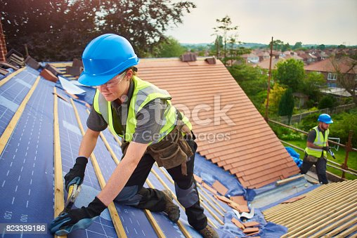 istock nailing the battens 823339186
