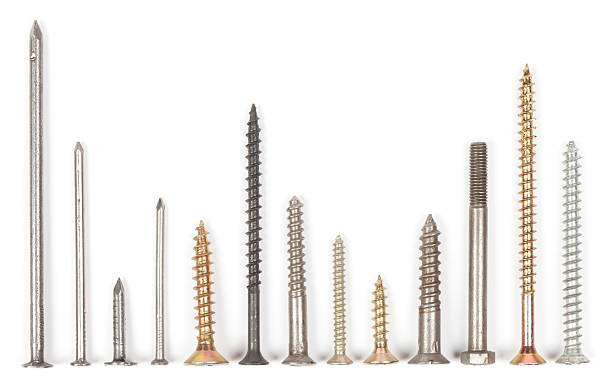 """Nails and screws """"Collection of screws and nails on white. This file is cleaned, retouched and contains"""" nail work tool stock pictures, royalty-free photos & images"""