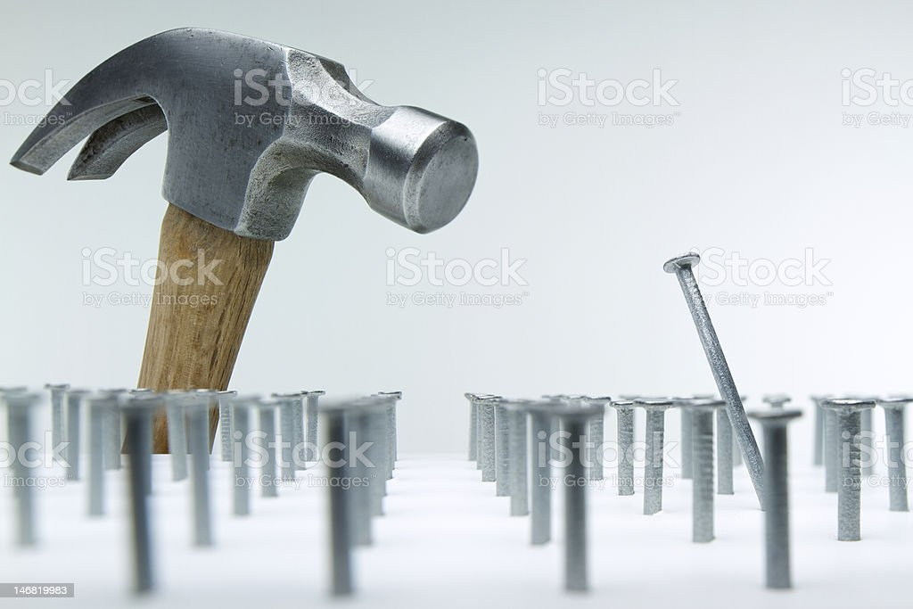 Nails That Stick Up Get Hammered Down Stock Photo & More Pictures of ...