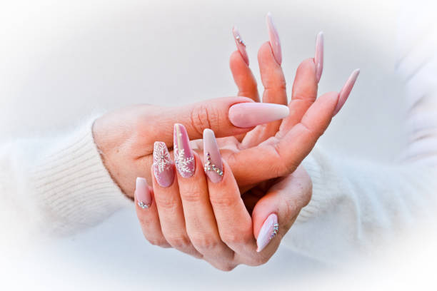 nails with pink Christmas decorations stock photo