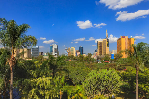 Nairobi, Kenya - Looking Across The Park To The Downtown Jomo Kenyatta Avenue In The Afternoon Sunlight: Nairobi Skyline stock photo