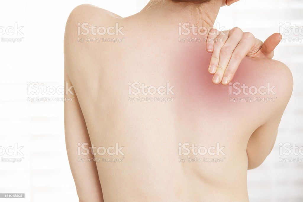 Naked back of a woman with shoulder pain royalty-free stock photo